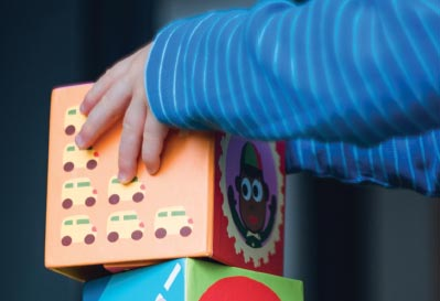 Kid's hands stacking colorful blocks