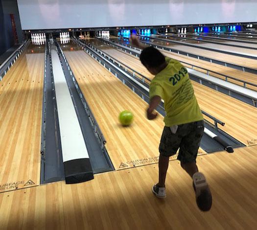Young boy bowling