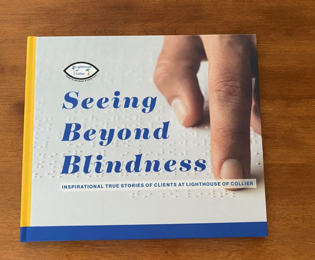 Seeing Beyond Blindness Coffee Table Book on wood table