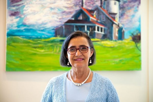 picture of Maggie in front of a lighthouse painting