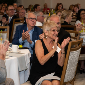 People clapping at the Harvey Kapnick Award Ceremony