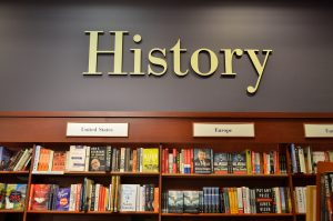 picture of the word History above shelves of books