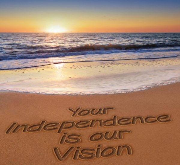 """beach and sun set - sand says """"Your Independence is our Vision"""""""