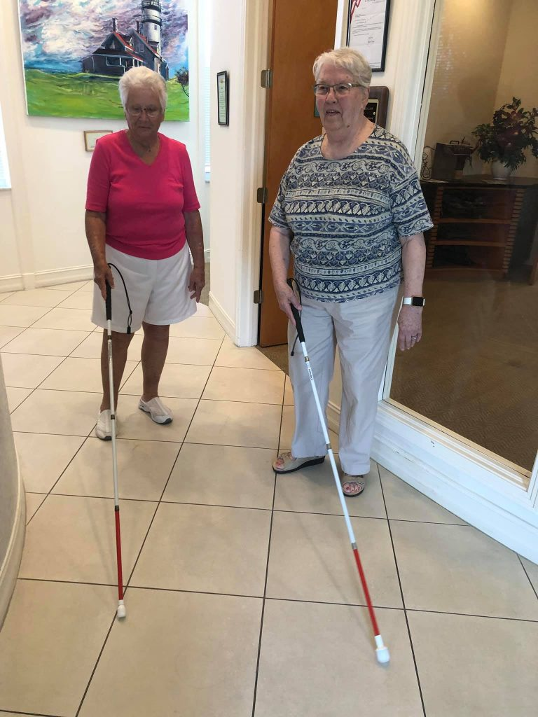 two women learning to use the white cane