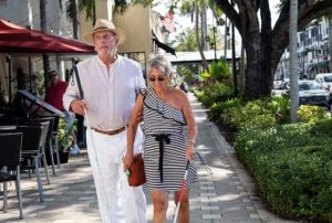 Couple walking with White Canes